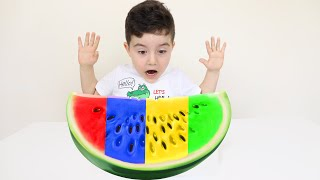 Yusuf play with Colored Watermelon