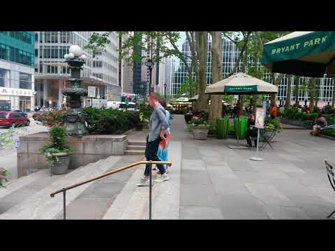 A nice and cozy park in the middle of manhattan on avenue of the Americas,