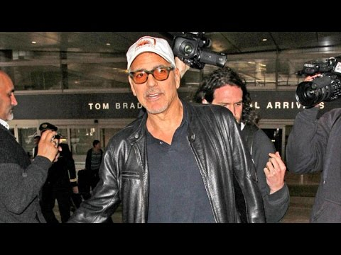 George Clooney Asked If He's Competitive With Beyonce Over Twins, Arriving At LAX From UK