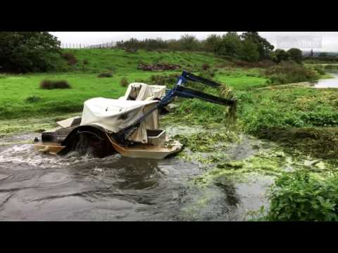 Weed cutter boats clearing a blockage on the Karamu stream