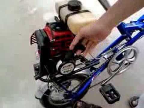 Xe đạp gắn máy cắt cỏ pro