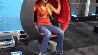 Sarah Austin in an Egg Chair with built in speakers