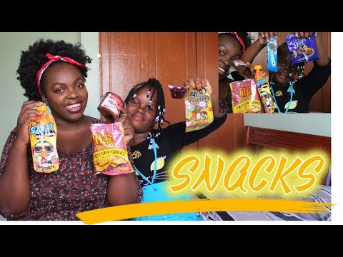 Kenyan Kid Trys Snacks from all over the world ,American Snacks Germany,Indian ,arabian Kemunto Bear