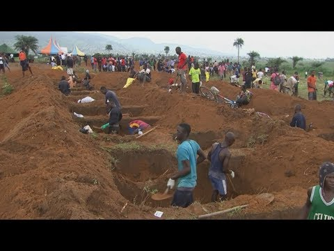Sierra Leone mudslide: Survivors dig mass graves for hundreds of victims