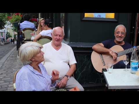 An Impromptu Street Performance In Montmartre. The Paris Of Édith Piaf.