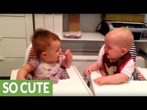 Twin babies engage in hysterical giggling fit