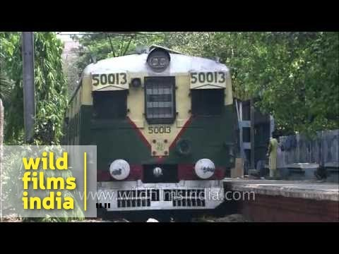 Local train passing through Eden Garden station Kolkata YouTube