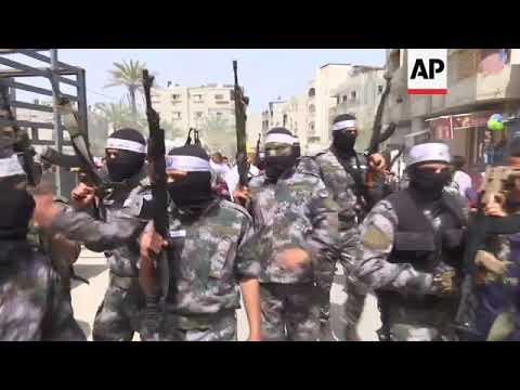 Fatah militants march through Gaza after Palestinian shot by Israeli troops