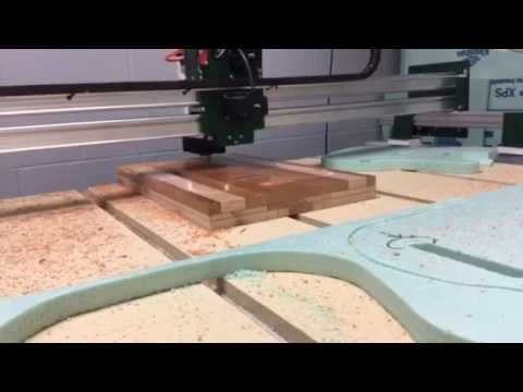 Gryphon CNC cutting a telecaster for a student project at The Donoho School