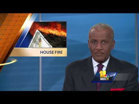 Video: Prince George's County officers run into burning home to save family