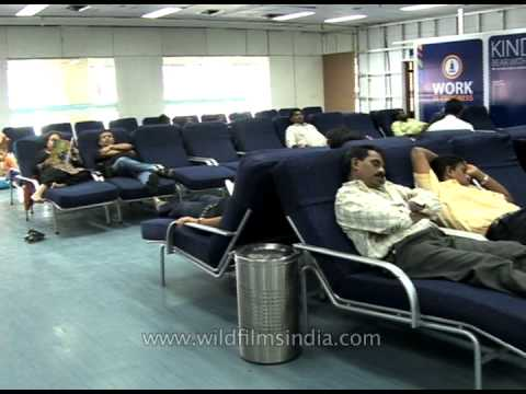 Passengers wait to board at departure lounge, Bombay airport