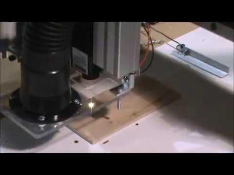 CNC laser burning Santa in wood