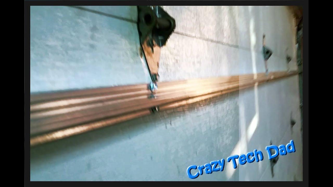 ez how to fix a popping buckling or banging garage door easy  [ 1280 x 720 Pixel ]