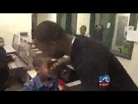 Military parents returning from deployment surprise children at school