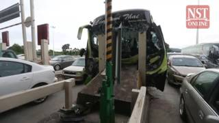 Bus ferrying 33 pupils and 4 teachers, crashes into toll booth divider, 10 reported injured