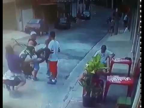 Three Guys Having Chat on Street Rammed by Out of Control Biker