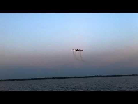 Navy P3 landing over water at NAS JAX