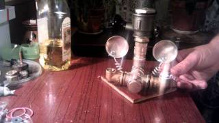 Vegetable oil lamp with two argand burners, filling and turning on