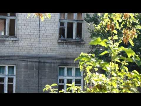 Последствия обстрела Партизанского проспекта в Донецке