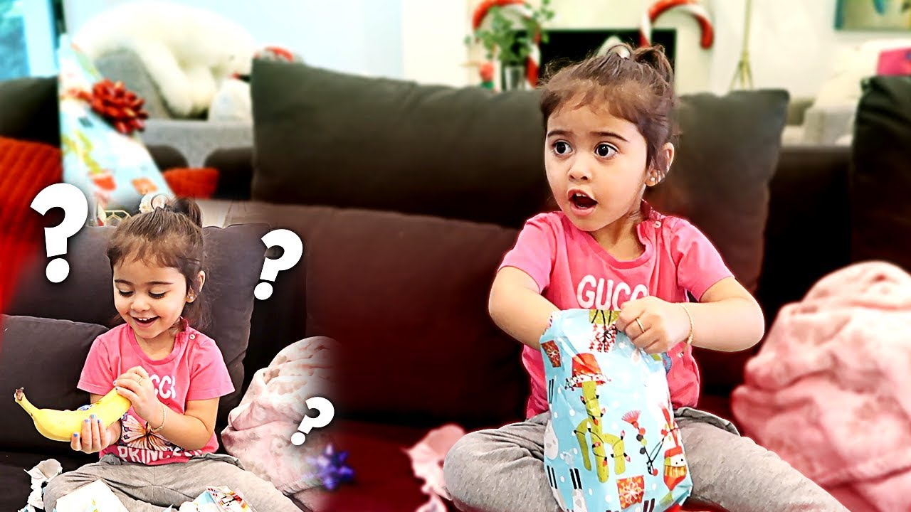 Family Christmas Gift Giving.Giving Elle Bad Christmas Gifts Prank Unexpected Reaction