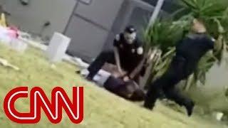 Cop kicks handcuffed suspect in the head