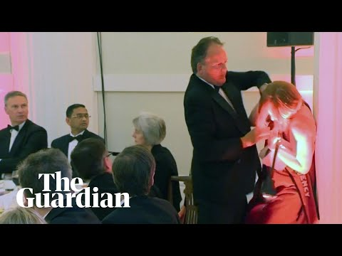 Mark Field grabs a climate protester by the neck – and parts of the right cheer him on
