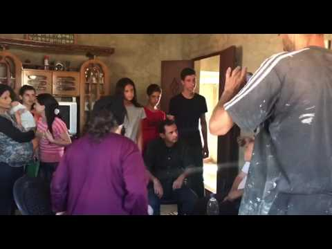 President of Syria Bashar Al Assad with his family visiting civilians/soldiers in Hama Syria