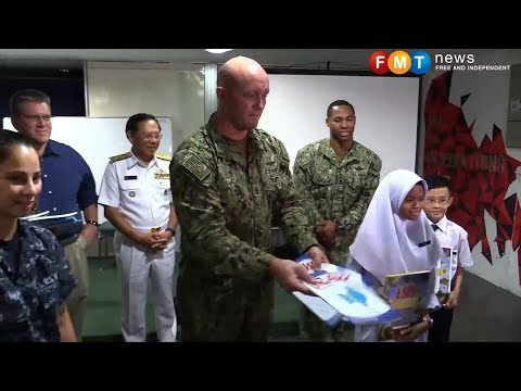 Military and US Navy team up in aid effort for poor children