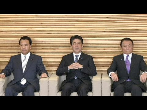 Japan's re-elected PM vows to push ahead with reforms