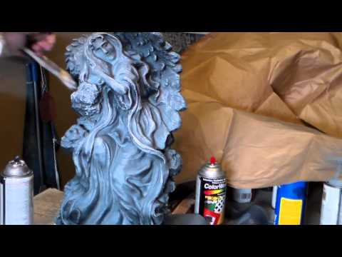 Painting and detailing a cement statue