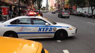 NYPD POLICE CRUISER RESPONDING ON WEST 54TH STREET IN MIDTOWN AREA OF MANHATTAN IN NEW YORK CITY.