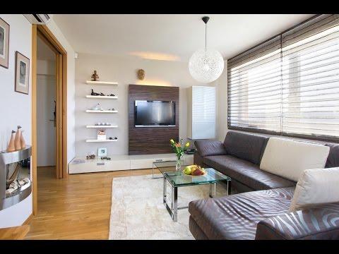 Как украсить стену с телевизором в гостиной