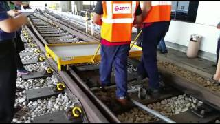 Demonstration using rail trolley to show how rail switching works