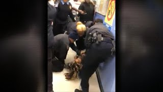 Video shows aggressive tug-of-war between NYPD and mom holding baby