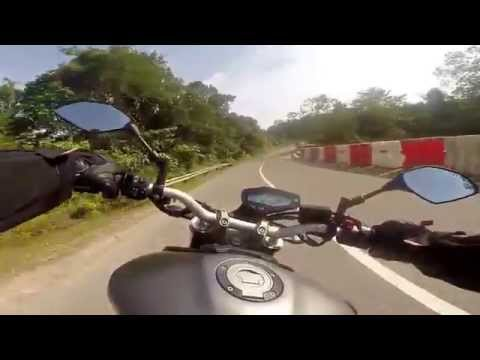 Cruising into Labi (Brunei) on a Yamaha MT-09