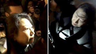 Hong Kong Justice Secretary flees hecklers in London