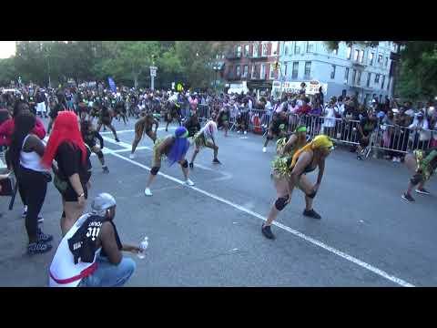 BLACK CARIBBEAN WEST INDIAN GIRLS CHEERLEADERS DANCERS PARADE IN HARLEM PARADE NEW YORK CITY