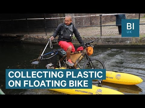 This man collects plastic waste from his floating bike