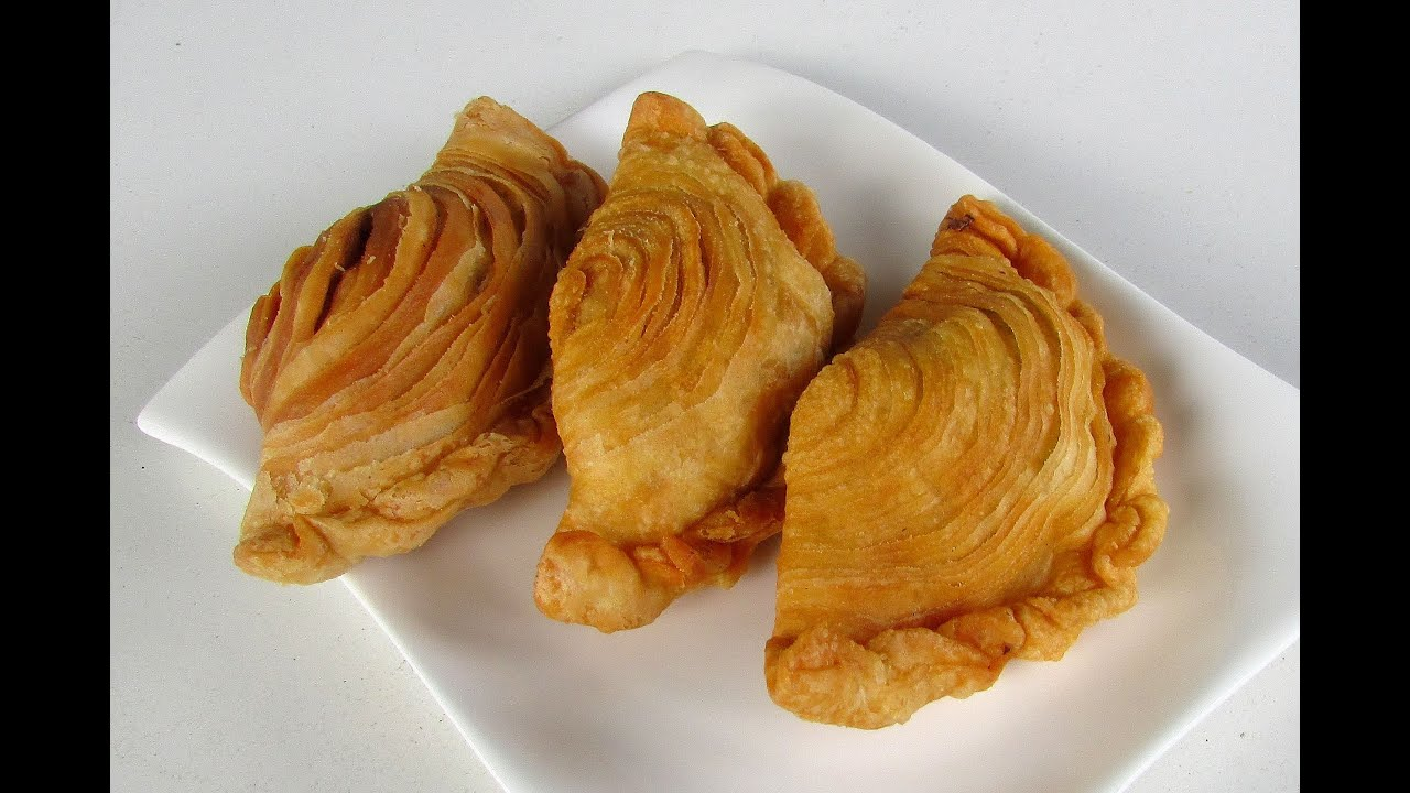 curry puff Curry puff is a snack of southeast asian origin it is a small pie consisting of curry with chicken and potatoes in a deep-fried or baked pastry shell the curry is quite thick to prevent it from oozing out of the snack.