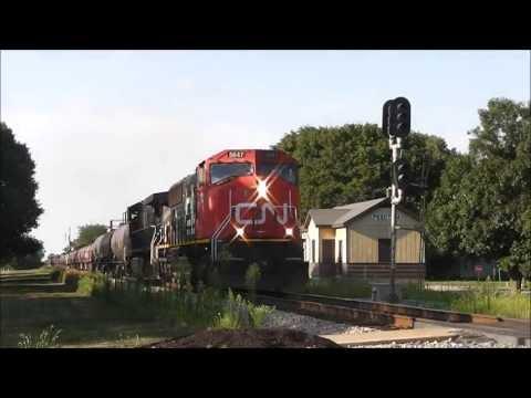 CN 5647 & BCOL 4652 with CN M397 at Pesotum, Illinois, 08.11.13