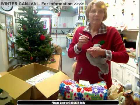 Jacci opening a christmas box from Spain