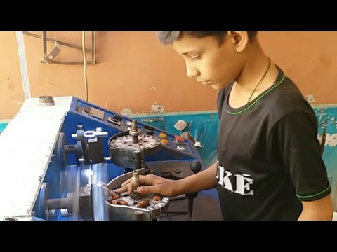 Little boy talent in Celling fan winding machine