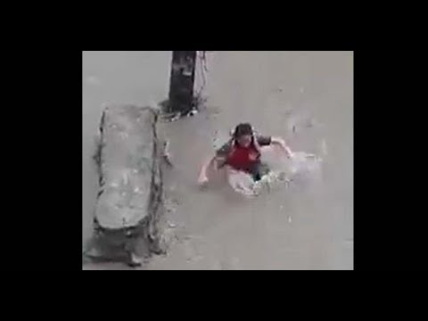 Shocking! Girl drown away while crossing the road in flood hit Kathmandu