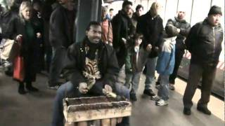 African timbre going uptown 14th St Union Square solitary musician, subway tunes 2011-02-26