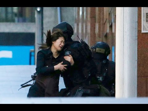DRAMATIC: Sydney siege hostages run from Lindt Cafe, more remain trapped