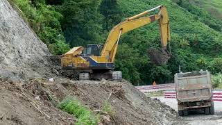 Backhoe Case 580 super R and Excavator working are digging hill