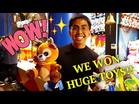 Trying to WIN  STUFF TOYS at the CARNIVAL