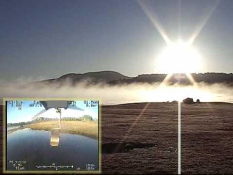 FPV Boomerang flight over a misty lake