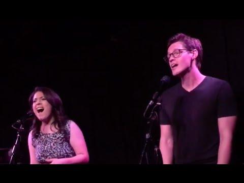 Caitlin Gallogly and Alec Medlock singing