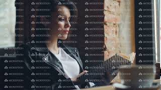 Attractive girl student reading book in cafe relaxing sitting at table alone
